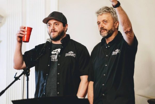 Christian and Bert Humbled holding up a cup